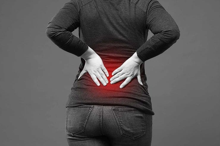 Woman complaining of severe lower back pain